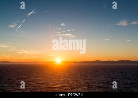 Sunset over the Mediterranean Sea, near Cannes, France - Stock Photo