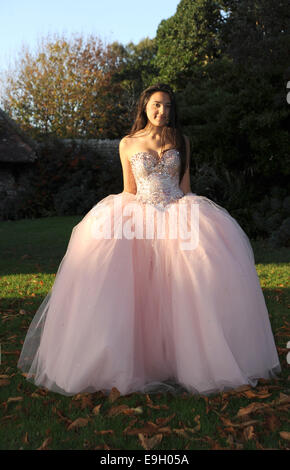 Teenage girl wears a pink princess style prom dress from Frock UK ...