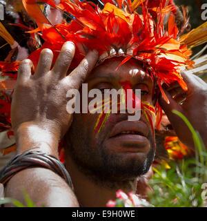 Building a Feather Headdress - Stock Photo