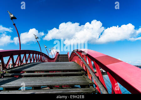 Red bridge between Borneo Eiland and Sporenburg Eiland, Eastern Docklands, Amsterdam, province of North Holland, The Netherlands Stock Photo