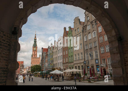 View through Green Gate or Brama Zielona towards the houses on Long Market or Długi Targ and the clock tower of - Stock Photo