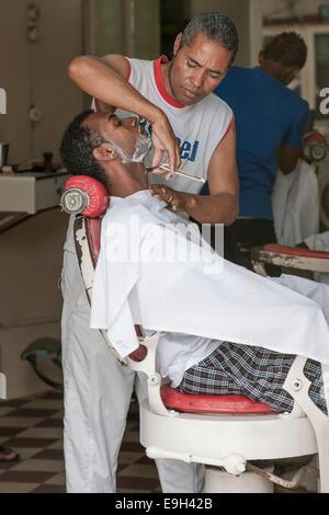 Barber at work, Mindelo, São Vicente, Cape Verde - Stock Photo