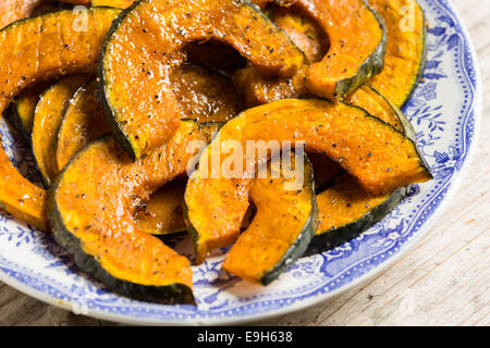 Roasted slices of pumpkin on a serving plate - Stock Photo
