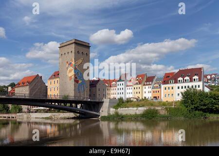 Pedestrian bridge over the Neisse River to Zgorzelec, grain silo of the former Dreiradenmuehle mill, Görlitz, Saxony, - Stock Photo