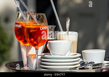 Glasses of Campari Soda with Cups of Coffee on Tray - Stock Photo