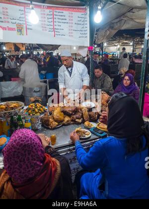 Night market, Place Jemaa el-Fnaa, with crowded street restaurants, Marrakech, Marrakech-Tensift-Al Haouz, Morocco - Stock Photo