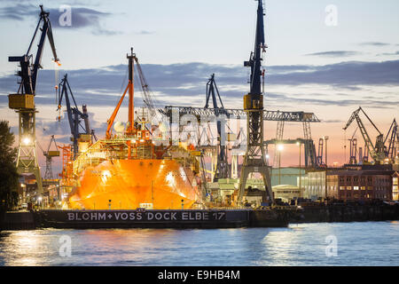 Container ship in a dry dock in the port, Hamburg, Hamburg, Germany - Stock Photo