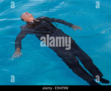 Senior man floating on back in water - Stock Photo