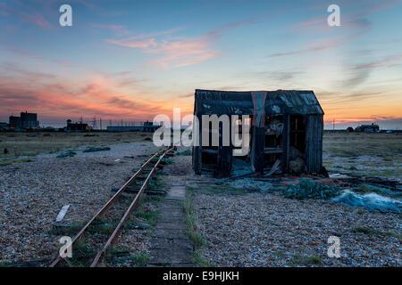Fishing hut on a shingle beach - Stock Photo