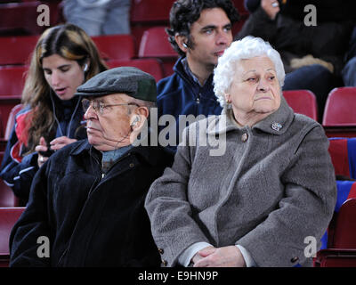 BARCELONA - NOV 10: Two old men watch a football match at the Camp Nou Stadium on the Spanish Cup. - Stock Photo