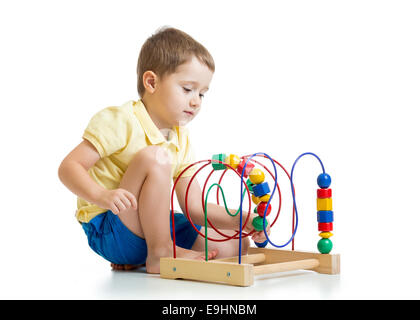 pretty kid boy plays with color educational toy - Stock Photo