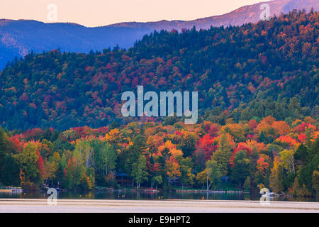 Autumn colors at Mirror Lake in Lake Placid in Adirondacks State Park in the northern part of New York State, USA