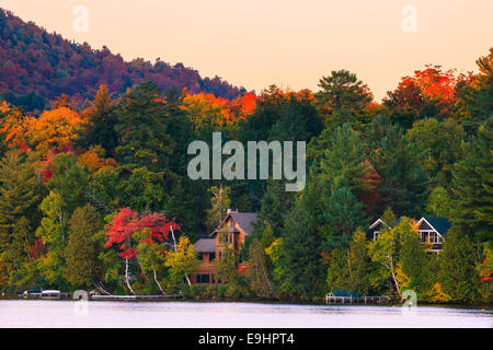 Autumn colors at Mirror Lake in Lake Placid in Adirondacks State Park in the northern part of New York State, USA - Stock Photo