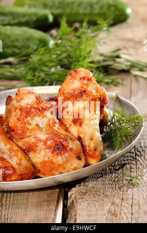 Fried chicken wings on wooden table - Stock Photo