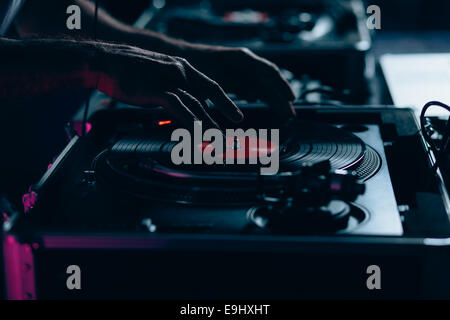 Male dj at work in night club. Shallow depth of field - Stock Photo