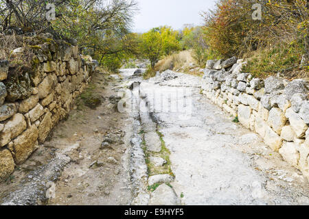 stone road on street of medieval town Chufut-Kale in Crimea - Stock Photo