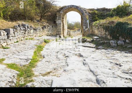 Gate on fortified Middle wall of ancient town chufut-kale, crimea - Stock Photo