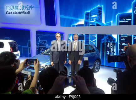 VWChina chief Jochem Heizmann (L) and VW development chairman Hans-Jakob Neusser explain the company's electric - Stock Photo