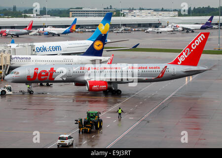 Jet2 Boeing 757-200 pushes back from terminal 1 at Manchester airport. - Stock Photo