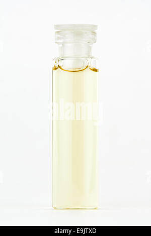 Closeup image of a bottle containing a liquid homeopathic extract/liquid on a white background. Shallow Depth of - Stock Photo