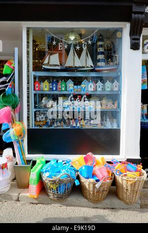 Buckets and spades for the beach on sale outside a seaside gift shop St Ives Cornwall England uk - Stock Photo