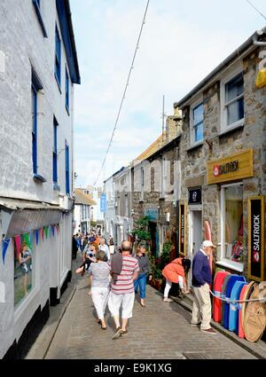 Tourists and visitors walking down Fore street St Ives Cornwall England uk - Stock Photo