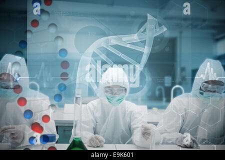 Composite image of chemists working in the lab with futuristic interface - Stock Photo
