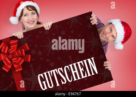 Composite image of couple both wearing santa hats - Stock Photo