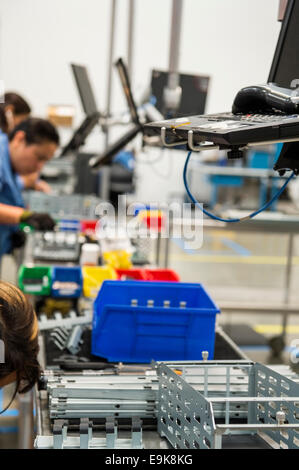 Cropped image of female engineers working in manufacturing industry - Stock Photo