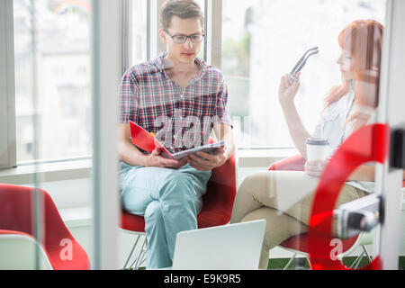 Business colleagues working in creative office Stock Photo