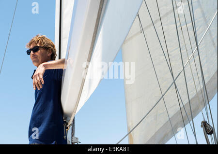 Side view of middle-aged man on yacht - Stock Photo