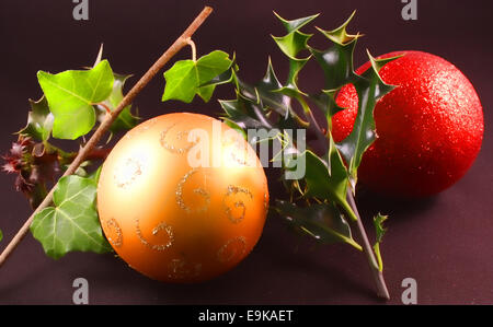 Christmas holly and the ivy with baubles - Stock Photo