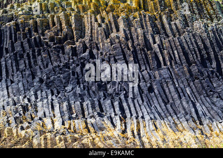 Columnar basalt formations on the island of Staffa in the Inner Hebrdes, Scotland - Stock Photo
