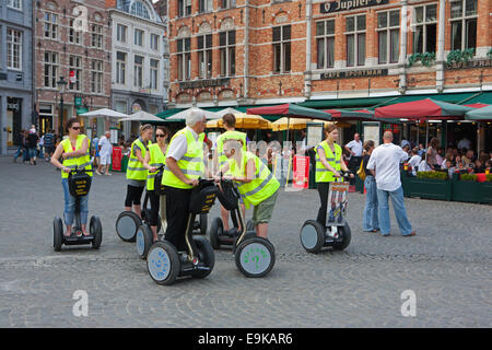 TOURISTS ON SEGWAY SIGHTSEEING TOUR IN BRUGES - Stock Photo