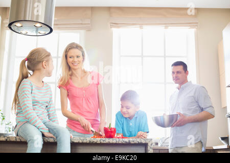 Family preparing food in kitchen - Stock Photo