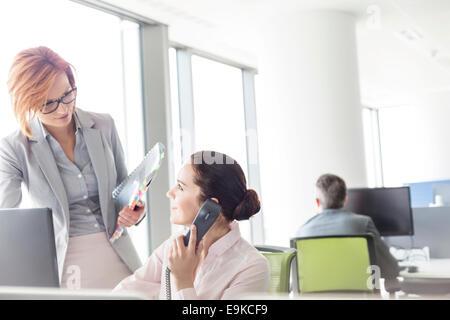 Businesswomen working in office - Stock Photo