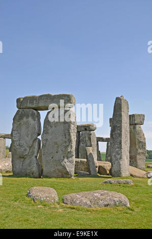A view of Stonehenge on a warm, sunny day, but no tourists in picture. - Stock Photo