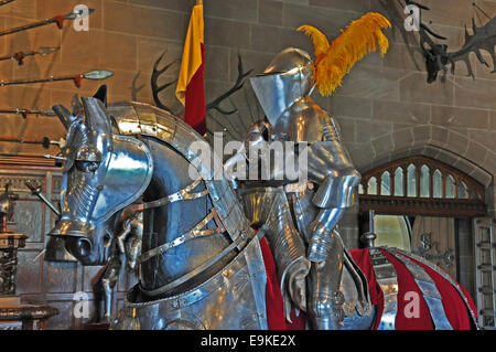 Warwick Castle - a model knight on horse, both in shining armour, on display. England, UK. - Stock Photo