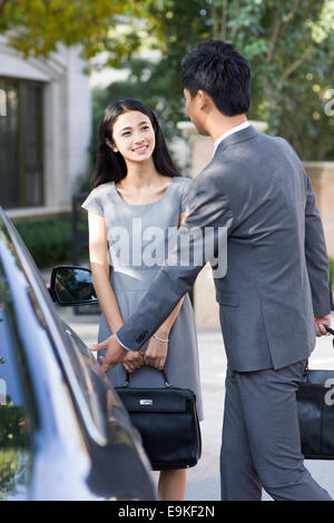 Young couple and car - Stock Photo