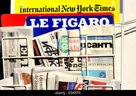 London, England, UK. Internation newspapers on a rack outside a newsagent - Stock Photo