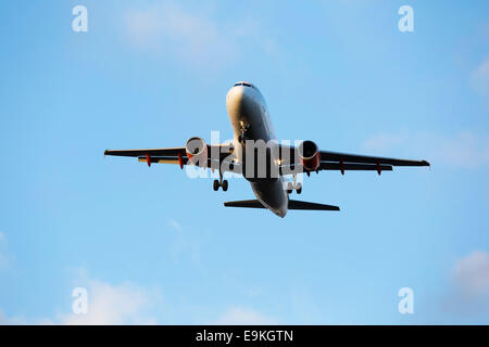 Airbus A320-214 G-EZTL Easyjet on approach to land at Manchester Airport - Stock Photo