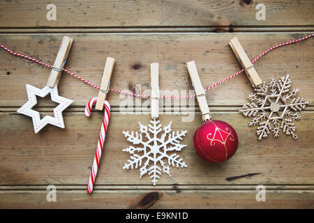 Christmas ornaments on a wooden background - Stock Photo