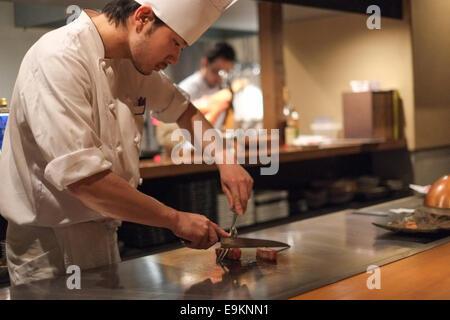 Japanese chef prepares Kobe beef - Stock Photo