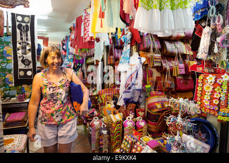 A woman tourist shopping in the indoor clothing market, Port Louis, Mauritius - Stock Photo