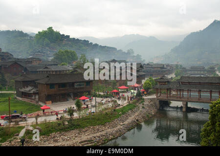 Foggy morning in Xijiang Miao village, Guizhou Province, China - Stock Photo
