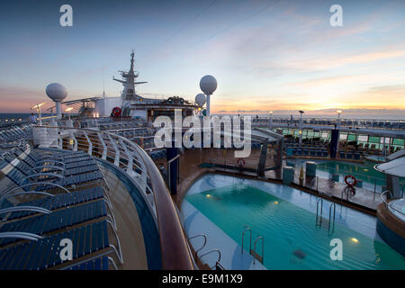 The deck and swimming pools on the Independence of the Seas Royal Caribbean cruise ship. - Stock Photo