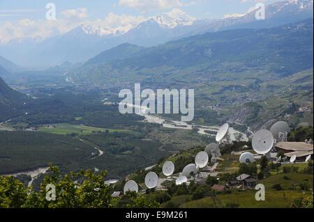 Parabolic antenna Satellite Land Earth Station Leuk, Valais, Switzerland. Onyx is a Swiss intelligence gathering - Stock Photo