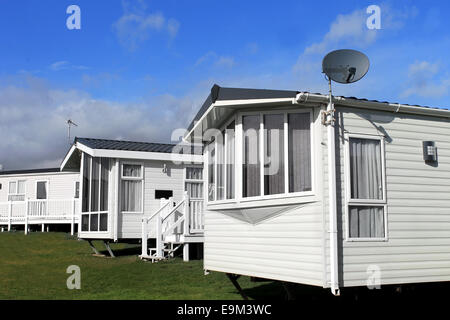Scenic view of a caravan or trailer park in summer with blue sky and cloudscape background. - Stock Photo