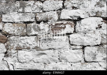 Abstract background of a painted white dry stone wall. - Stock Photo