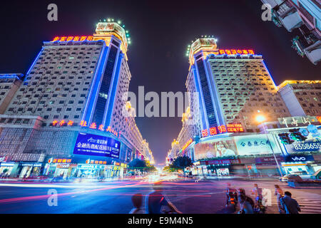 FUZHOU, CHINA - JUNE 16, 2014: Bayiqi Street at night. The street is the oldest shopping district in the city. - Stock Photo